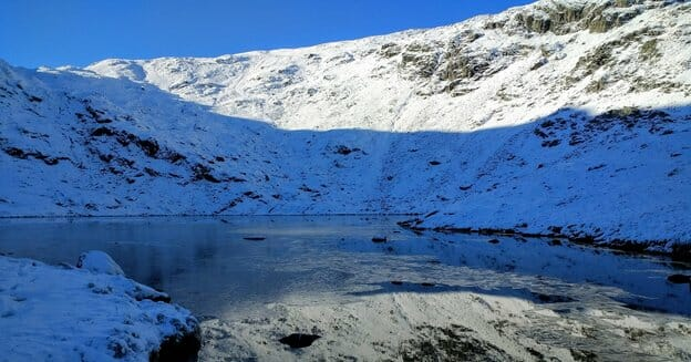 Tarn in the snow above Haweswater