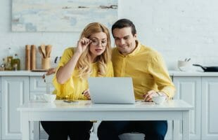 couple looking at laptop on a table