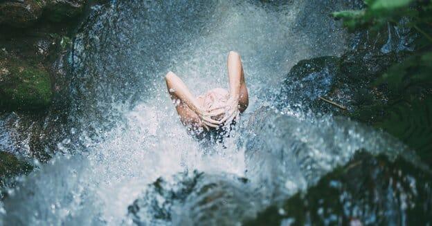 shower for free under the rocks for super frugal living tips
