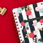 red background, life planner notebook