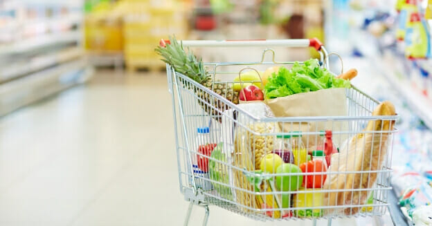 grocery cart with food in it