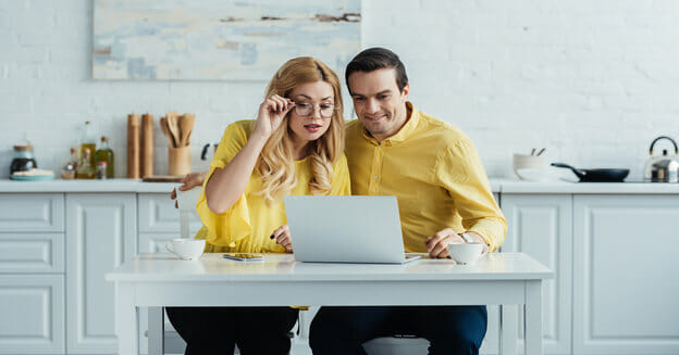 couple at table with laptop