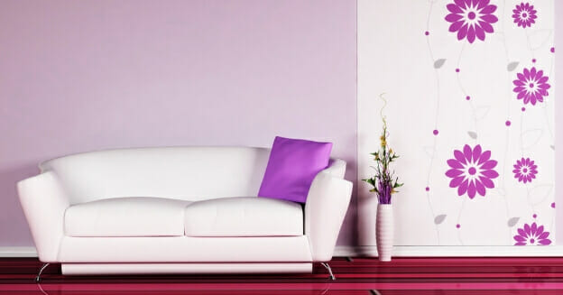 white sofa with red striped carpet and purple cushion