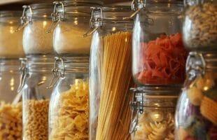 Shelf of dry pasta in jars