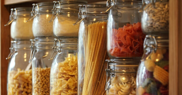 Shelf of dry pasta in jars