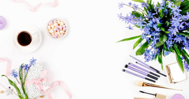 pens, coffee cup and blue flowers - frugal living bloggers