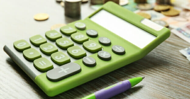 green calculator with money in background